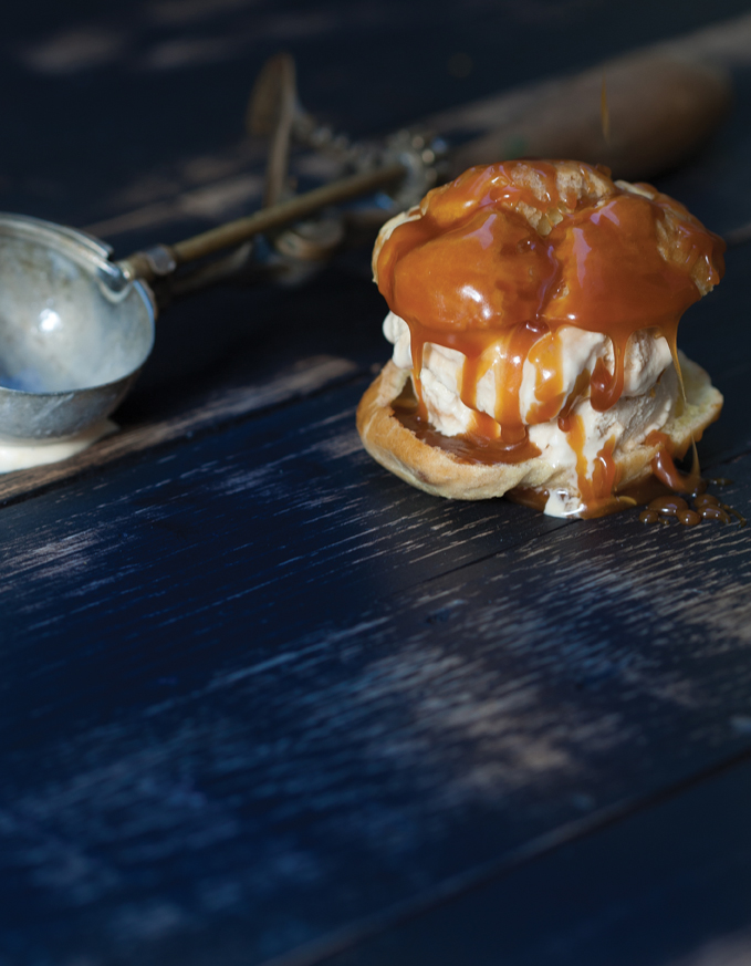 Profiterole with Salted Caramel Macadamia Ice Cream and Hot Caramel Sauce. Photo by Alexandra DeFurio.
